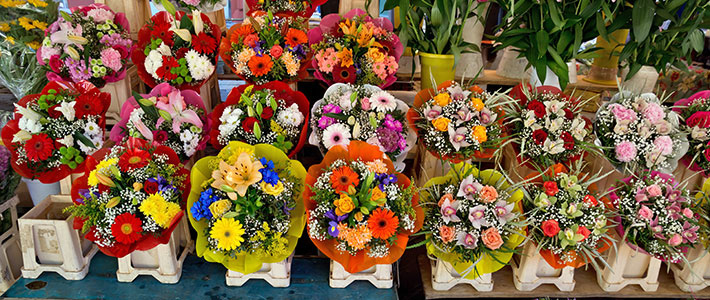 image of different coloured flowers at a market